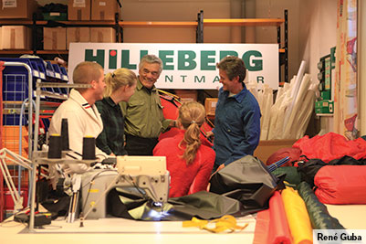 The design team looking at the design for a new tent.