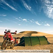 Simon and Lisa Thomas camped in their green Keron GT in sand dunes in India while riding near Jaislmer.
