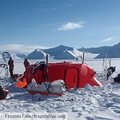 The Frozen Five and their two red Keron GTs in the sun in Greenland.