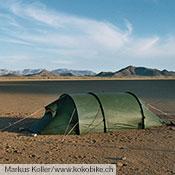 A Nammatj GT provides shelter in a Namibian desert.