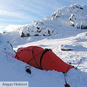 A red Tarra in a snow covered mountain range in Australia.