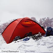 A red Unna with gear in the snow on Mt. Rainier.