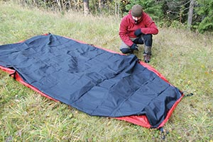 Insert the red toggles on the Footprint into the rings around the perimeter of the tent. Turn the tent over and pitch as usual. & Practical tips for using your Hilleberg tent