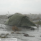 Our Black Label tents are designed not only to offer full adaptability to and ease of handling in both fine and foul conditions, but also to maximize durability. Here a 30 year old Nammatj stands strong against some truly ugly conditions.