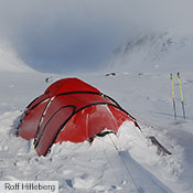 "Hilleberg tents are as at home in the most remote places as they are right out your back door. Here a new Saitaris easily weathers a storm with in the Hilleberg's ""back yard"" – a mountain pass only 85 km/53 mi as the crow flies from the Hilleberg offices in Jämtland, Sweden."