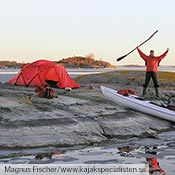 A Tarra on the rocky shore of Sweden during one of Magnus Fischer's winter Kayak expeditions.